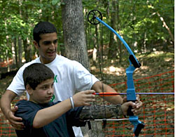 Photo: camper learning archery