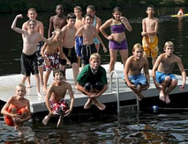 Photo: campers jumping into lake
