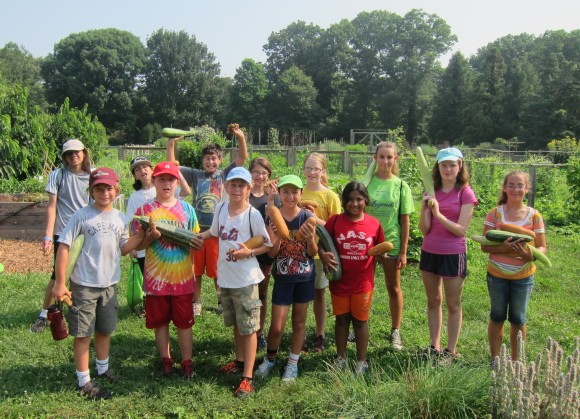 Exploration Summer Campers harvest vegetables at Rutgers Gardens.