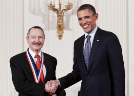 Ralph Brinster poses with President Obama after receiving the National Medal of Science in 2010.