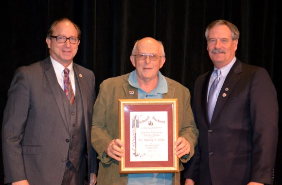 Wes Kline receiving the Distinguished Service to NJ Agriculture award at the NJ Agricultural Convention. (L-R) NJ Department of Agriculture Secretary Doug Fisher, Wesley Kline and Robert Swanekamp, president of the NJ State Board of Agriculture