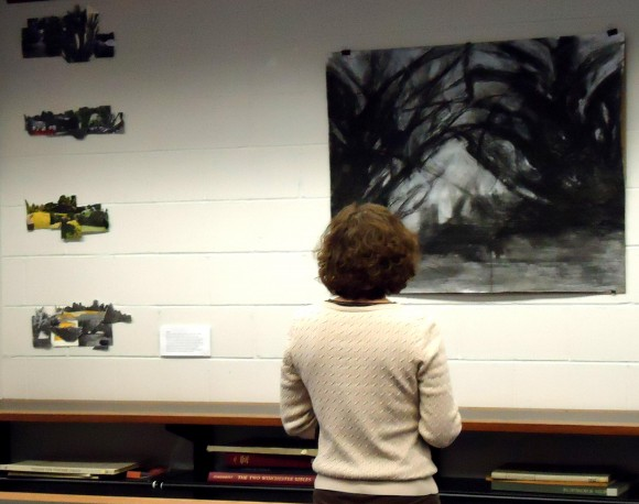 LA Department Chair Laura Lawson studies Burhalter's charcoal interpretation of Rutgers Gardens yews.