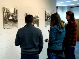 Students view Burhalter's work while on display at Rutgers' Art Library
