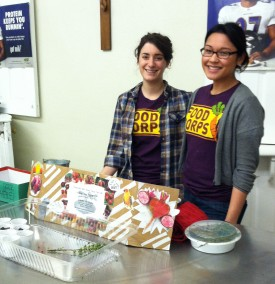 Alexis Sangalang (right) with fellow FoodCorps service member Lauren Ladov conducting a beet tasting for students in Camden.