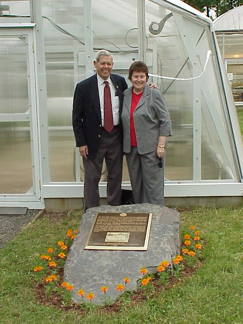 William Roberts and his wife Dottie at the dedication of the first air inflated double polyethylene greenhouse on Cook campus as a historical national landmark.