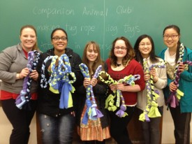 Nealon (third from left) with fellow members of the Companion Animal Club, showing the tug rope toys they crafted for dogs.