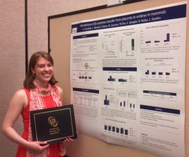 Costabile with her poster award at the annual meeting of the American Society for Nutrition in San Diego.