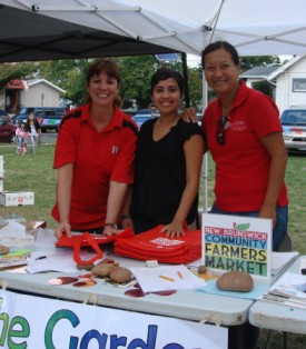 Christine (right) at the nutrition table at the New Brunswick Community Farmers Market with Patricia Munoz, Rutgers Office of Institutional Diversity and Inclusion, and Emily Ijalana, community assistant at EFNEP.