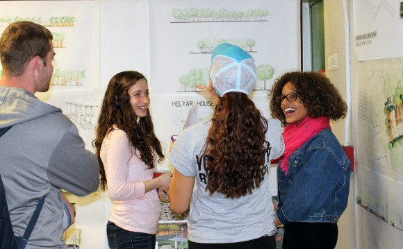 L-R: Students Austin Scott, Andreia Ruela, Sarah Cortwright and Amber Betances examine the designs proposed fro Helyar House landscape makeover.