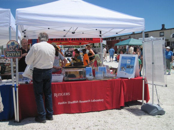 HSRL director Dave Bushek shares information at the lab's exhibit booth with festival participant.