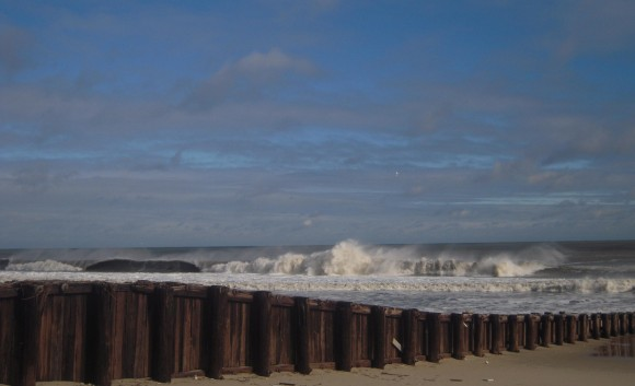Waves crash on Manasquan beach in winter.