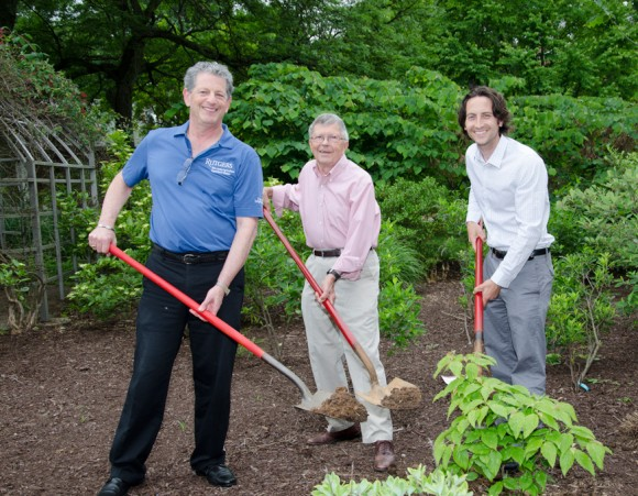 Larry Katz, Elwin Orton and Tom Molnar plant a Red Pygmy® dogwood for the 100th anniversary of Cooperative Extension.