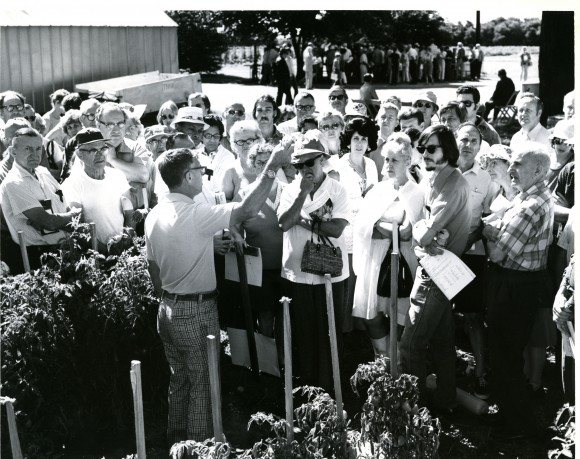Bernard Pollack (center left) displaying tomato at Rutgers NJAES on-campus Open House in 1967.