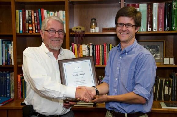 Executive Dean Bob Goodman presents Malin Pinsky with Powe Award plaque