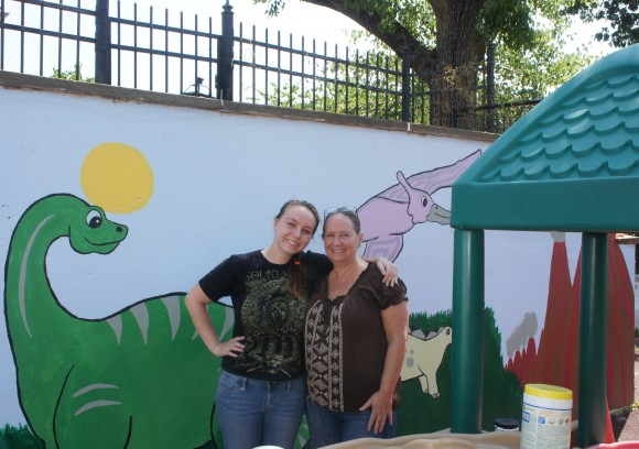 Jaclyn Daddio (l), with her mother Susan in front of the newly renovated mural at the Rutgers Nutritional Sciences Preschool.
