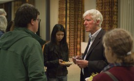 Lester Brown (right) talks with Rutgers students after his 2013 visit to campus for a lecture and book signing.
