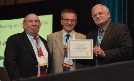 L-R: Leonard Katz, president of the Society for Industrial Microbiology and Biotechnology, Max Häggblom and Keith Bostian  of the Waksman Foundation for Microbiology.