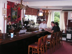 Todd Hunt (r) at the bar area of the Rutgers Club.
