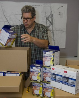 Jim Simon sorting supplies bound for Liberia at the REHS building on the Livingston campus.