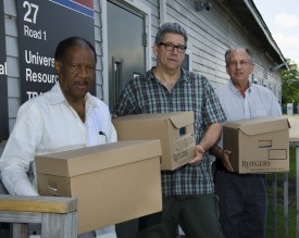 Emmet Dennis, Jim Simon and Tom Block with boxes of supplies bound for Liberia.