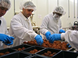 Natale Grande and The Flying Meatball team inspecting, sorting and packaging gourmet meatballs. Photo credit: The Flying Meatball Company.