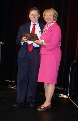 IUMS Vice President Steven Lerner with Joan Bennett, who received the Stuart Mudd Award for Studies in Basic Microbiology.