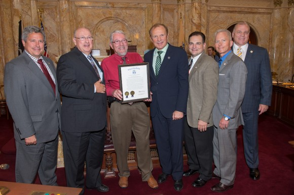 L-R: Sen. Kip Bateman (R-16), Sen. Bob Smith (D-17), Robert M. Goodman, Executive Dean of the School of Biological and Environmental Sciences, Sen. Ray Lesniak (D-20), Sen. Nick Scutari (D-22), Sen. Jeff Van Drew (D-1) and Senate President Stephen Sweeney hold a joint N.J. Legislature resolution that honors Rutgers on the 150th anniversary of its designation as the state's land-grant institution