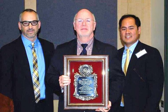 Robson receiving the Dennis Sullivan Award, with (left) nominator Mr. Peter Tabbot, health officer and (right) Dr. Oliver Lontok, NJPHA president.