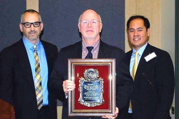 Robson receiving the Dennis Sullivan Award, with (left) nominator Mr. Peter Tabbot, health officer and (right) Dr. Oliver Lontok, NJPHA president.