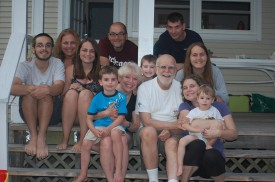 Barbara and Tom Pluta, center, surrounded by family on their traditional family vacation at Cape Cod.