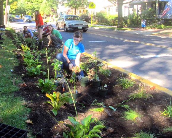 Volunteers planting a curb-cut rain garden in with the RCE Water Resources Program. RCE Water Resources Program.