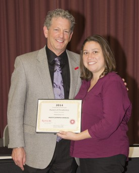 Larry Katz presents Marycarmen Kunicki with the RCE Award of Excellence for a Program Associate. Photo: Jeff Heckman