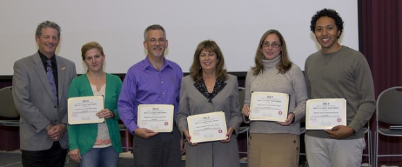 (L-R) Larry Katz awards Annie's Project team members Meredith Melendez, Nick Polanin, Robin Brumfield, Jenny Carleo and Jeff Heckman.