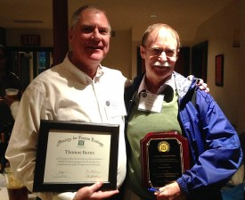 Tom Rudel, at right with a plaque honoring him with the 2014 Gerald L. Young Book Award from the Society of Human Ecology. With him is University of Oklahoma colleague Thomas Burns. Courtesy of Tom Rudel.