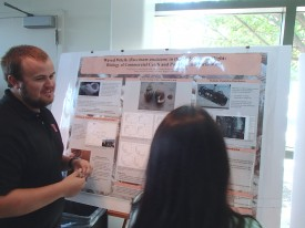 Collin Dobson and his award-winning poster.