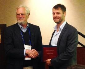Ben Horton receiving the 2014 Ocean Voyager Award at the AGU annual meeting in December.