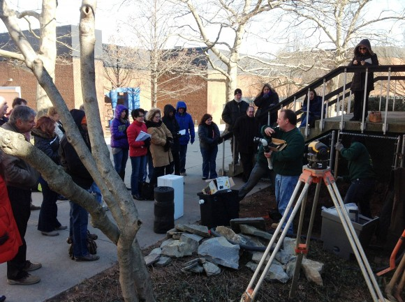 """Participants at the Rutgers Home Gardener School learn from an outdoor demonstration by Robert Belleck, owner, Lily Pad Ponds LLC, teaching a pond design & installation hands-on workshop. This year Belleck will teach a """"pondless"""" water feature workshop."""