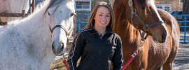 Cook Campus; Brooke Domin with horses at the Equine Science Center
