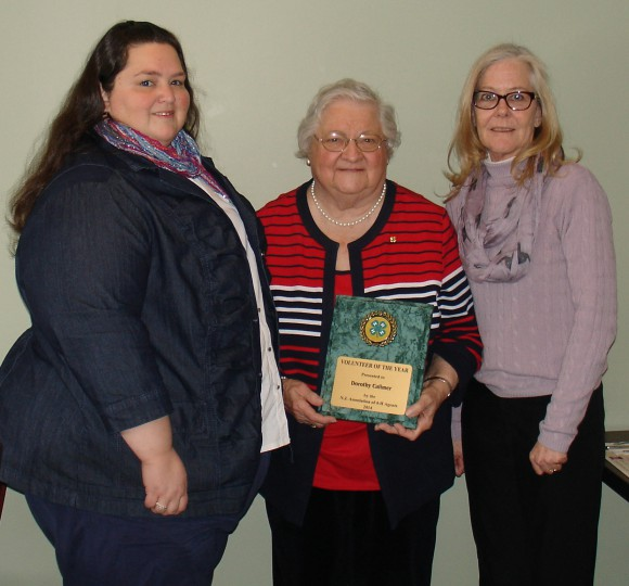 Debi Cole (left) and Navonne Owen (right), Atlantic County 4-H staff and members of the New Jersey Association of 4-H Agents presented the 4-H Volunteer of the Year Award to Dorothy Calimer of Cologne.