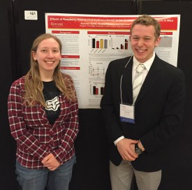 Graduate student Jessica Verpeut (l) is also an author on the poster with Brandon Smith (r).