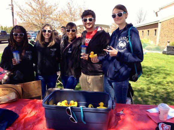 "Rutgers Oceanography Club members at the Ag Field Day 2015 ""What the Duck"" booth where prizes were given for correct answers to marine trivia questions."