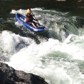 An active sports enthusiast, Kate rafts down the middle fork of the Salmon River in Idaho.