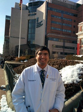 Proud alum Dan Mascarenhas wears the Scarlet R as he makes his rounds at the University of Maryland School of Medicine. Here he is pictured outside one of the university buildings in February 2015.