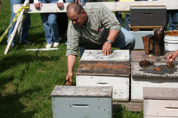 New Jersey State Apiarist Tim Schuler works on a hive at one of OCPE's popular Bee-ginner's Beekeeping classes.