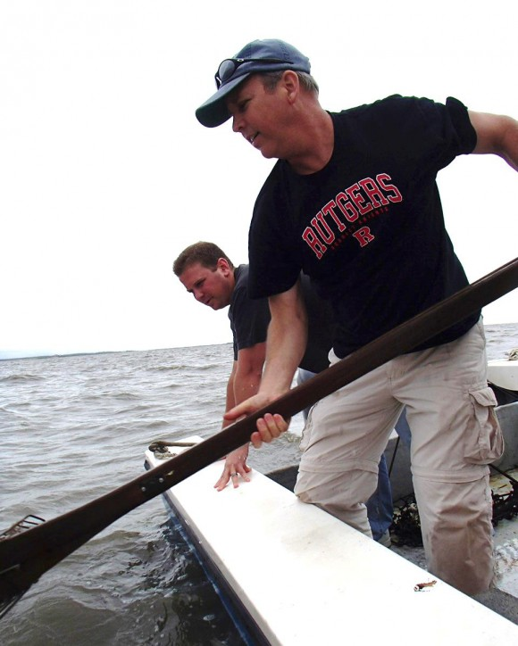 David Bushek uses oyster tongs to collect samples from Delaware Bay. In the background is Jason Morson, researcher at the Haskin Shellfish Research Laboratory.