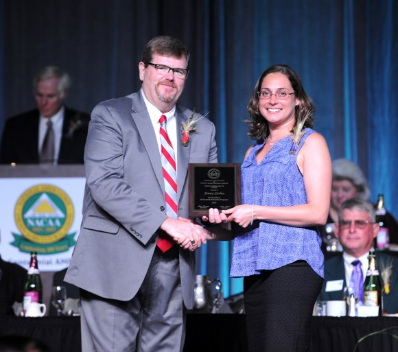 Mike Hogan, 2015 President of the National Association of County Agricultural Agents, presents the Distinguished Service Award to Jenny Carleo. Photo: Kevin Blayney.