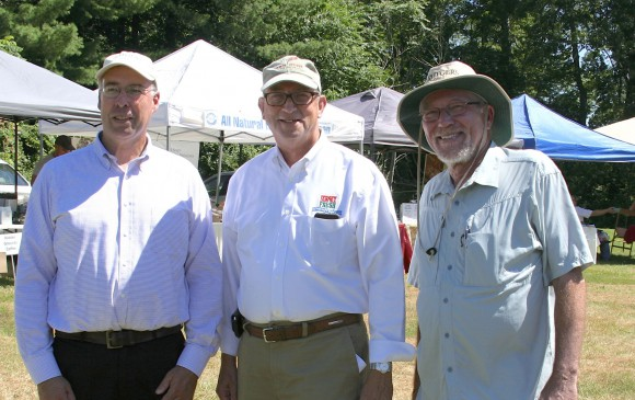 "NJ Secretary of Agriculture Douglas H. Fisher, center, during a recent visit the Rutgers Gardens Farmers Market as part of his two-day ""Jersey Fresh Love Tour,"" making stops at farms, farmers markets, and wineries to highlight the peak of Jersey Fresh season in the Garden State. He's accompanied, at left, by Bruce Crawford, director of the Rutgers Gardens and Bob Goodman, executive dean of agriculture and natural resources at Rutgers."