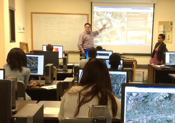 David Tulloch instructs participants inthe GeoHealth Worksop held at CRSSA on the Cook Campus. Alejandrina Canelo Villafana, Ph.D. canidate from Columbia University, looks on..