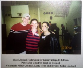 Justin Gayliard with volunteers Mindy Andino and Kelly Ryan at the Halloween event in 2002.
