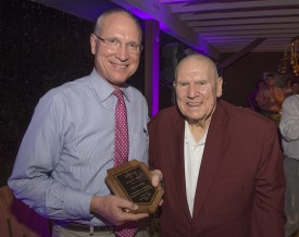Kent Hiteshaw (CC'76) presents the Dedication and Outstanding Commitment award to Roy DeBoer at the 7th annual Rutgers Garden Gala.